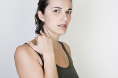 Shoulderache woman Stock Photos