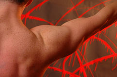 Shoulders. Male shoulder on neon red abstract background Stock Photos