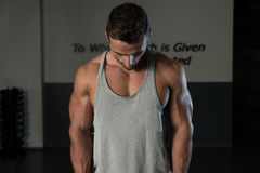 Shoulders Cable Lateral Raise Exercise. Body Builder Workout On Cable Machine. Standing Low Pulley Deltoid Raise Stock Photos