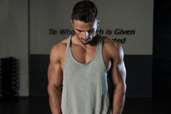 Shoulders Cable Lateral Raise Workout. Body Builder Workout On Cable Machine. Standing Low Pulley Deltoid Raise Stock Images