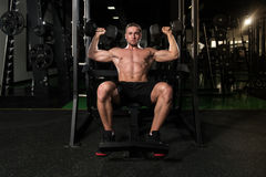 Shoulders Exercise With Dumbbells In A Gym Stock Photo