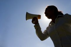 Shout!. Silhouette of woman shouting with a megaphone stock photos
