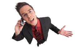 Shout. Businessman talks on the phone with clipping path included Royalty Free Stock Photography