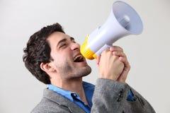 Shout loud. Business man shouting through megaphone Royalty Free Stock Photography