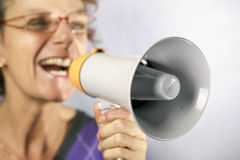 Shouting. Woman shouting through a megaphone Stock Image