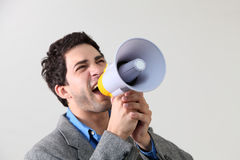 Shouting. A Businessman shouting through megaphone Royalty Free Stock Photo