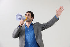 Shouting. A Businessman shouting through mega phone Royalty Free Stock Image