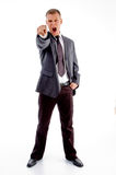 Shouting adult businessman pointing at camera. Shouting adult accountant pointing at camera on an isolated white background Royalty Free Stock Photography