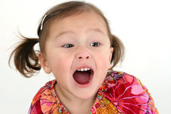 Shouting Asian girl. Portrait of cute Asian girl with mouth open shouting, isolated on white background Stock Images