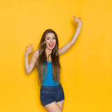 Shouting Beautiful Young Woman With Arm Rased Stock Photo