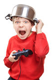 Shouting boy with gamepad in hands Stock Images