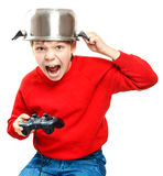 Shouting boy with gamepad in hands Stock Image