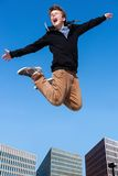 Shouting boy jumping in city. Stock Photography