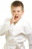 Shouting boy in kimono. Photo against white background Stock Photo