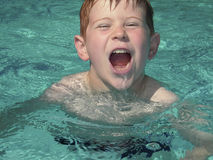 Shouting boy in pool Stock Photography