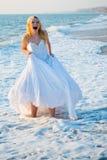 Shouting bride in sea spume Royalty Free Stock Photos