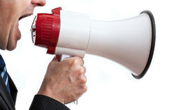 Shouting businessman. Businessman holding megaphone and shouting, isolated Stock Photography