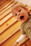 Shouting Child. Child shouting while sitting on a staircase Royalty Free Stock Photos