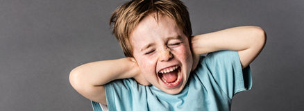 Shouting child with red hair and attitude ignoring parents scolding Stock Images