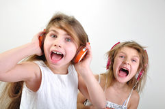 Shouting children with headphones Stock Photography