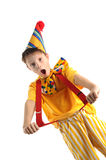 Shouting clown boy. Expressive shouting boy wearing bright carnival costume royalty free stock photography