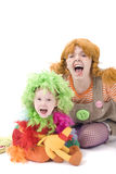 Shouting Clowns. Shouting Colorful dressed Mother and daughter Stock Image