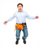 Shouting construction worker jumping Stock Image