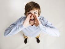 Shouting do homem novo Imagens de Stock Royalty Free