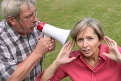 Shouting into the ear Stock Images