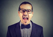 Screaming angry young expressive man stock image