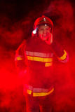 Shouting fireman in smoke. Stock Images