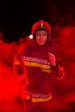Shouting fireman in smoke. Stock Image