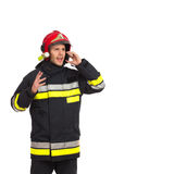 Shouting fireman using phone. Royalty Free Stock Images