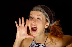 Shouting girl. Isolated in black Royalty Free Stock Image