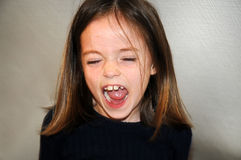 Shouting girl. Angry little  girl is shouting with open mouth Royalty Free Stock Photography
