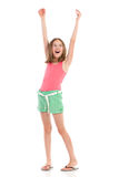 Shouting girl with arms raised. Looking away. Full length studio shot isolated on white Royalty Free Stock Image