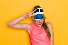 Shouting Girl In Blue Sun Visor Cap Royalty Free Stock Photos