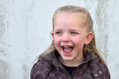 Shouting girl. Cute toddler girl shouting with wide open mouth Stock Photo
