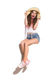 Shouting Girl in Hat Sitting on a Banner Royalty Free Stock Photography