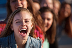 Shouting Girl Outside. Young happy white teenage girl shouting with friends Royalty Free Stock Photography