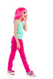 Shouting girl in pink wig. Pink haired girl in sunglasses shouting. Full length studio shot isolated on white Stock Photos
