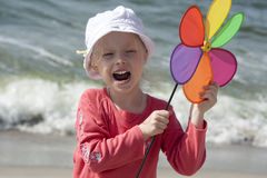 Shouting girl with pinwheel Stock Image