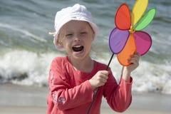 Shouting girl with pinwheel Stock Image