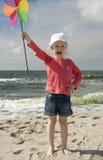 Shouting girl with pinwheel II Stock Photos