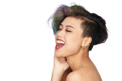 Shouting girl. Portrait of beautiful shouting Asian woman with dyed hair Royalty Free Stock Photography
