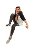 Shouting girl sitting on a banner Royalty Free Stock Photos