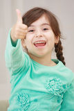 Shouting girl with thumb up Royalty Free Stock Images