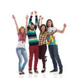 Shouting group of college students. Four young happy people shouting with arms raised. Full length studio shot isolated on white Stock Photography