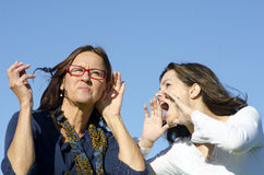 Shouting and listening between two generations Royalty Free Stock Images