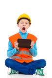 Shouting little construction worker showing a digital tablet Stock Photo